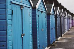 Beach Huts. Blue to navy tones Royalty Free Stock Images
