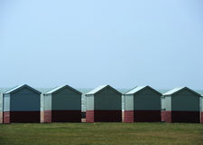 Beach huts in Brighton. A row of beach huts on the beach at Brighton, East Sussex Royalty Free Stock Photos