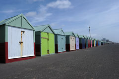 Beach huts in Brighton. A row of beach huts on the beach at Brighton, East Sussex Stock Photos
