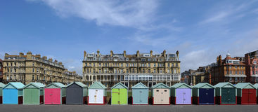 Beach huts in Brighton. A row of beach huts on the beach at Brighton, East Sussex Royalty Free Stock Image