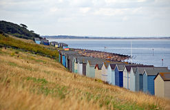Beach huts by coast Royalty Free Stock Photo