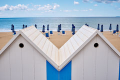 The beach  huts on coast Royalty Free Stock Images