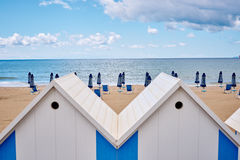 The beach  huts on coast Stock Images