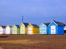 Beach huts. Colourful beach huts on a shingle beach Royalty Free Stock Photos