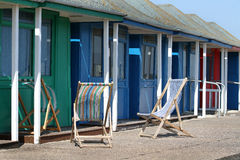 Beach huts and deck Chairs. Stock Photos