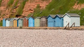 Beach Huts in Devon. Beach huts and the pebble beach in Budleigh Salterton, Jurassic Coast, Devon, UK stock image