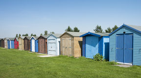 Beach huts at Dovercourt, near Harwich, Essex, UK. A group of colorful beach huts at Dovercourt, near Harwich, Essex, UK Royalty Free Stock Image