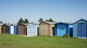 Beach Huts at Dovercourt, near Harwich, Essex, UK. A row of colourful beach huts at Dovercourt, near Harwich, Essex, UK Stock Photo