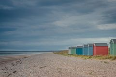 Beach Huts At Findhorn, Scotland, UK. Colorful Huts on the Moray Firth Coast at Findhorn Beach, Scotland, UK Stock Photography