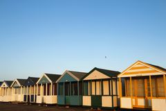Beach huts in golden sunlight Royalty Free Stock Photos