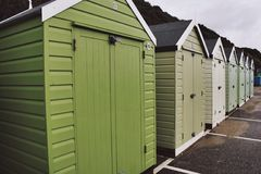 Beach Huts. Green to light green tones Royalty Free Stock Images