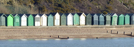 Beach huts, Hampshire. A line of traditional English beach huts on England's south coast Royalty Free Stock Images