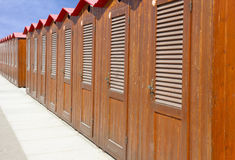 Beach huts in Italy. Row of wooden beach huts Royalty Free Stock Photos