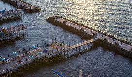 Beach huts and jetty in Sorrento, Campania, Italy. Beach huts and jetty in the port of Sorrento, near Naples, Campania, Italy Royalty Free Stock Photography