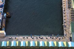 Beach huts and jetty in Sorrento, Campania, Italy Royalty Free Stock Photos