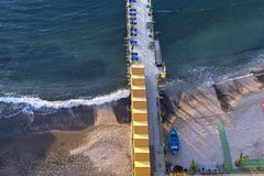 Beach huts and jetty in Sorrento, Campania, Italy. Beach huts and jetty in the port of Sorrento, near Naples, Campania, Italy Stock Photos