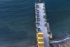 Beach huts and jetty in Sorrento, Campania, Italy Stock Photos