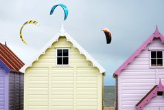 Beach huts and kites Stock Photography
