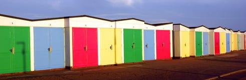 Beach huts lines up in Devon. stock photos