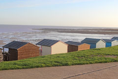 Beach Huts at Low Tide Royalty Free Stock Photos