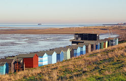 Beach huts at low tide Stock Photo
