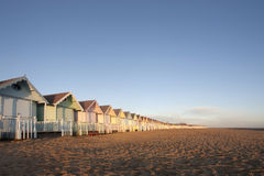 Beach huts at mersea, essex. A line of pastel coloured beach huts at mersea in essex, uk Royalty Free Stock Image