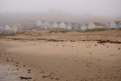Beach huts on a misty morning Stock Images
