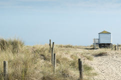 Beach huts on Mudeford sandbank Stock Photo