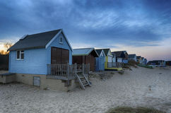 Beach Huts at Dusk. Beach huts on Mudeford Spit at Hengistbury Head near Christchurch just after sunset Royalty Free Stock Photography