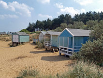 Beach huts at Old Hunstanton. Beach huts in the sand dunes on the North Norfolk beach Royalty Free Stock Photos