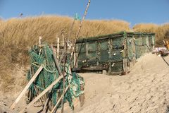 Beach Huts and other Objects out of Flotsam and Jetsam. AMRUM, GERMANY - JANUARY 02, 2018: On the Kniepsand Beach of  the North Frisian Island Amrum in Germany Royalty Free Stock Image