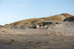 Beach Huts and other Objects out of Flotsam and Jetsam. AMRUM, GERMANY - JANUARY 02, 2018: On the Kniepsand Beach of  the North Frisian Island Amrum in Germany Royalty Free Stock Photo