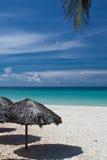 Beach huts and palm leaf. Beach huts, sea and palm leaf, Varadero, Cuba Stock Image