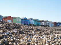 Beach Huts on pebble beach. Colourful beach huts on the English coastline Royalty Free Stock Photo