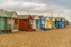 Beach huts on a pebble beach stock photography