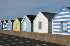 Beach huts on pier Stock Images