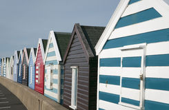 Beach huts on pier in Southwold Stock Photos