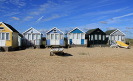 Beach Huts. Pretty beach huts on the beach at Mudeford, with a cloudy sky Royalty Free Stock Photo