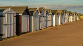 Beach huts on the promenade stock photos