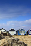 Beach Huts and Rock Stock Photo