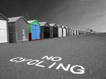 Beach huts in a row. Beach huts in Hove in black and white with one hut in colour stock photo