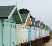 Beach huts. A row of pastel coloured beach huts Stock Image