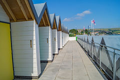 Beach Huts in a Row. Swanage beach huts waiting for the holidaymakers Royalty Free Stock Image