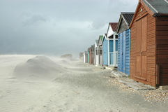 Beach huts & sand Stock Images