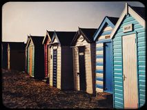 Beach huts on the sand on a cold winter day Royalty Free Stock Image