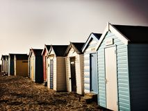 Beach huts on the sand on a cold winter day Royalty Free Stock Photos