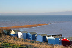 Beach huts and sandbank Royalty Free Stock Photography