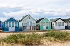 Beach huts on sandy dunes on English coast Stock Photography