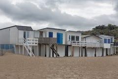 Beach huts at Sangatte. Beach huts on the Plage de Bleriot beach in Sangatte, Hauts-de-France under dark clouds Stock Photo
