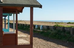 Beach and sea at Worthing, Sussex, England. Beach huts and sea at Ferring near Worthing, West Sussex, England Stock Photos